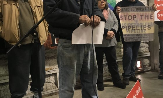 A landowner rips up an offer of compensation from PennEast at a rally February 2, 2018.